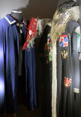 Cloak and bicorn hat with student emblems from the 20th century